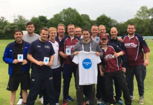 group of club cricketers showing the opening up tshirt